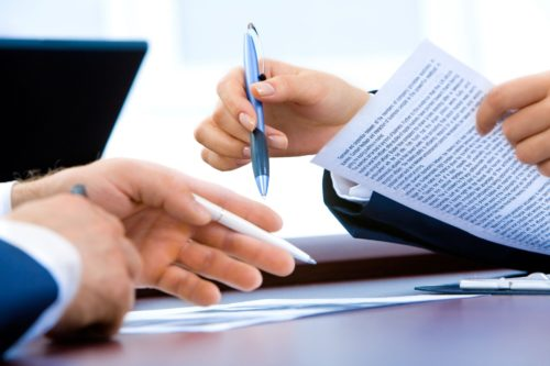 two people looking at documents